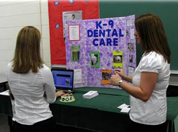 Students participate in a Table Clinic competition during Dental Health Services Open House.