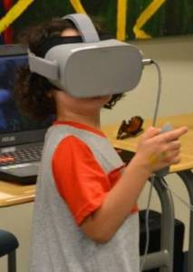 Little boy wearing virtual reality goggles/headset
