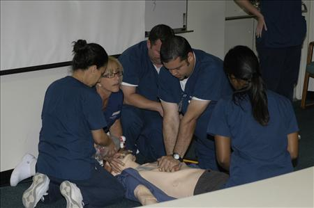 Students practicing a simulated experience.