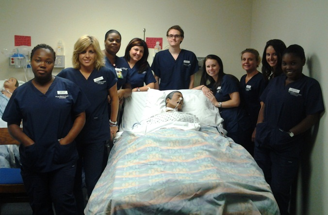 Nursing students with a mannikin