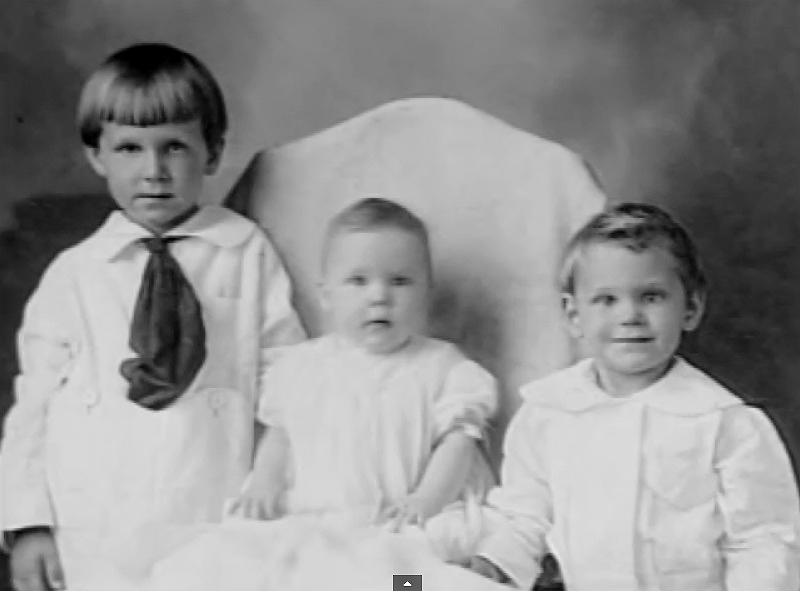 Watson B. Duncan, left, with siblings.