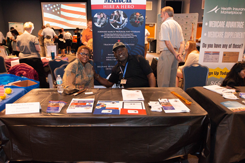 Table and representatives at the Veteran's Expo