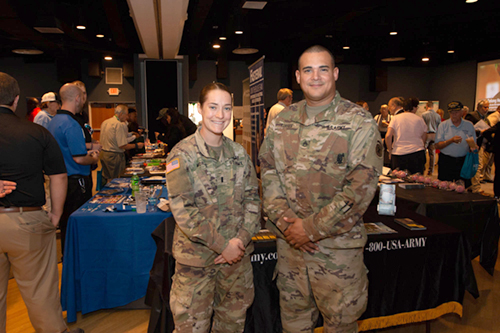 Military service members in uniform at the Veteran's Expo