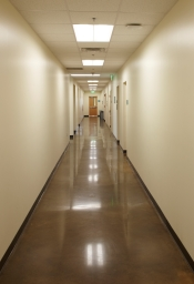 second floor corridor with polished stained concrete floor.