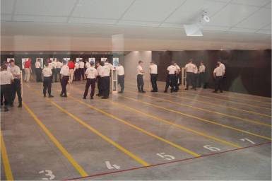 law enforcement recruits during a training session in firing range.